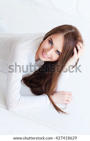 Portrait of young beauty woman smiling