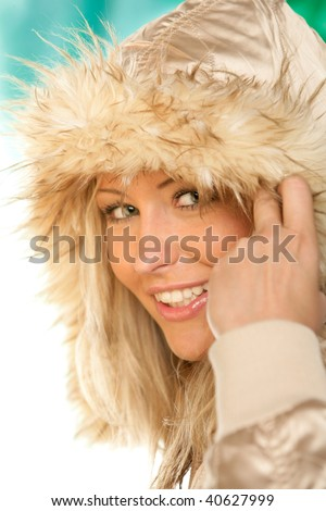 Portrait of young beauty woman wearing hooded parka