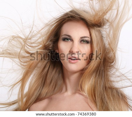 Portrait of young beauty woman with fluttering hair