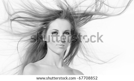 Portrait of young beauty woman with flying hair