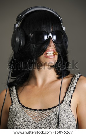 Portrait of young bizarre woman with headphones - stock photo
