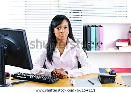 Portrait of young black business woman at desk in office