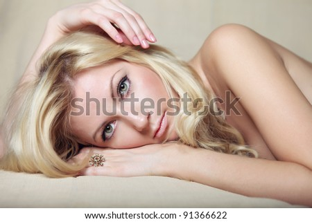 portrait of young blond attractive woman - stock photo