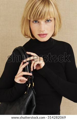 Portrait of young blond businesswoman - stock photo