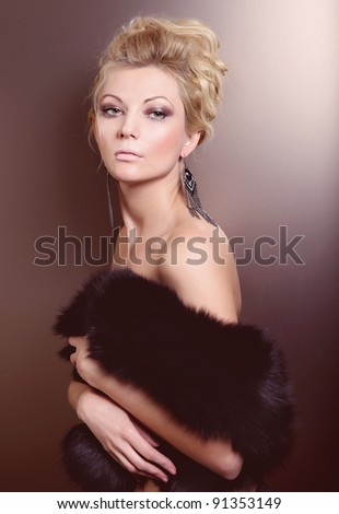 portrait of young blond woman in fur - stock photo