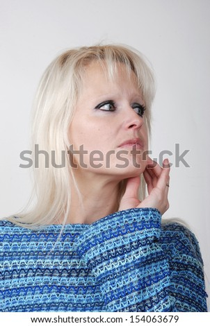 Portrait of young blond woman thinking and looking somewhere up