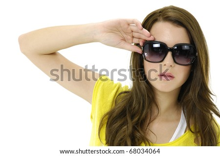 Portrait of young blonde girl in fashion dress wearing sunglasses - stock photo