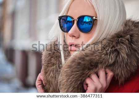 Portrait of young blonde model outdoors - stock photo