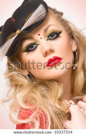 portrait of young blonde with kitty mask - stock photo
