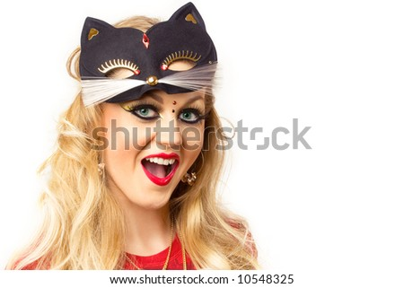 portrait of young blonde with kitty-style make-up - stock photo