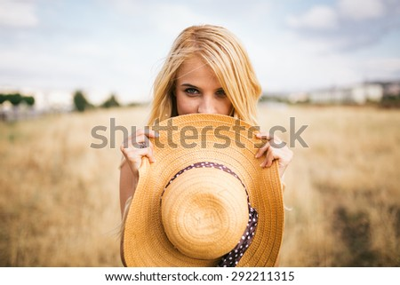 Portrait of young blonde woman in nature. - stock photo