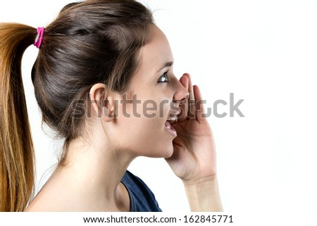 portrait of young blonde woman whispering gossip - stock photo