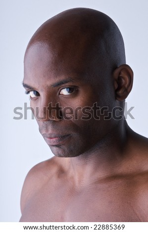 Portrait of young body builder african american, looking at camera.