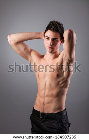 Portrait of young bodybuilder man on a black background
