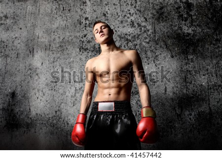 portrait of young boxer on grunge background - stock photo