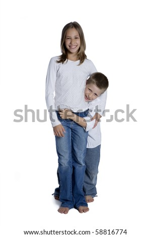 Portrait of young boy and girl hugging each other, studio shot isolated on white background - stock photo