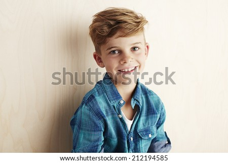 Portrait of young boy checked shirt, smiling  - stock photo