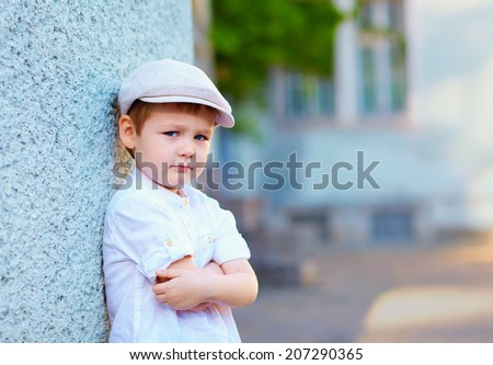 portrait of young boy, countryside - stock photo