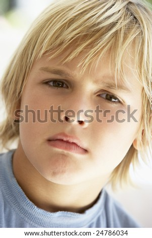 Portrait Of Young Boy Frowning - stock photo