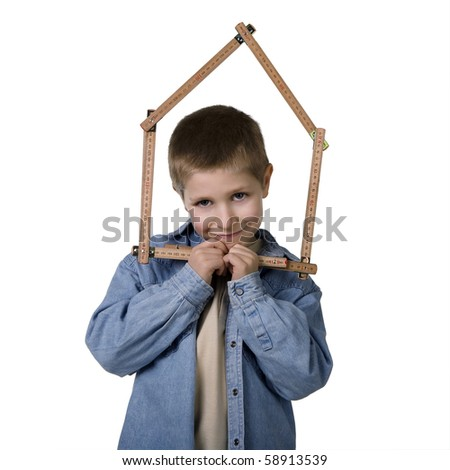 Portrait of young boy holding house-shaped measuring tape, studio shot isolated on white background - stock photo