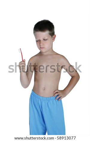 Portrait of young boy holding toothbrush and making a face, studio shot isolated on white background - stock photo