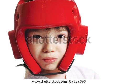 Portrait of young boy in helmet with gum shield isolated on pure white background - stock photo