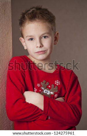 Portrait of young boy in red pajama - stock photo