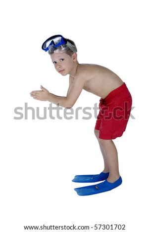 Portrait of young boy in swimsuit and snorkeling gear preparing to dive - stock photo