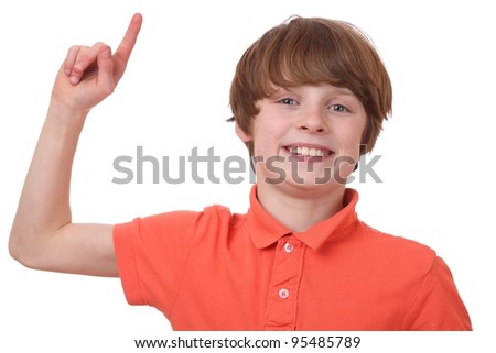 Portrait of young boy raising his index finger isolated on white background - stock photo