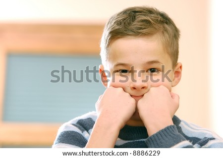 Portrait of young boy thinking - stock photo