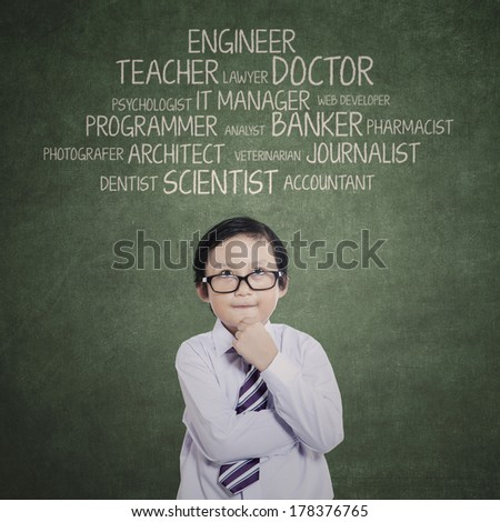 Portrait of young boy thinking his aspirations  - stock photo
