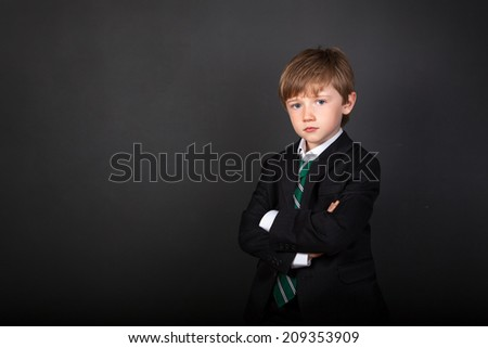 Portrait of young boy wearing suit