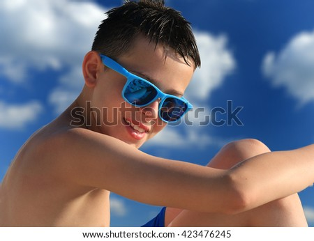 Portrait of young boy wearing sunglasses