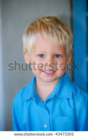 portrait of young boy with blue eyes - stock photo