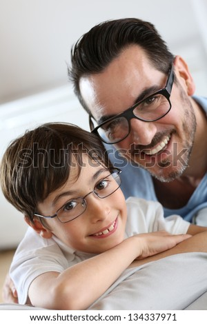 Portrait of young boy with daddy with eyeglasses on - stock photo