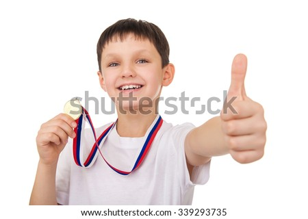 Portrait of young boy with golden medal - stock photo