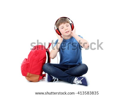 Portrait of young boy with headphones on white background