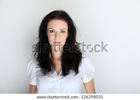 Portrait of young brunette woman in a formal dress code - stock photo