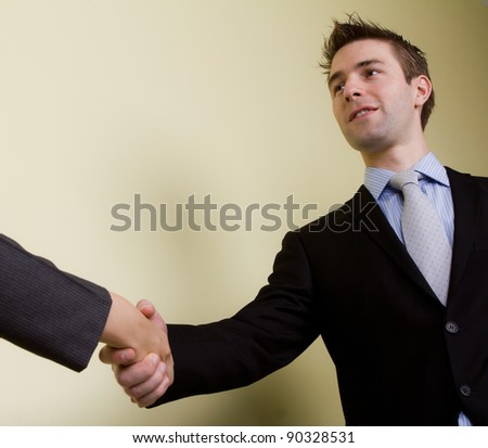 Portrait of young business man  hand shake in the office - stock photo