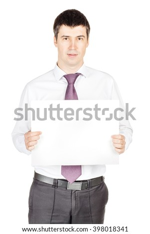 Portrait of young business man holding a blank banner. image on a white studio background. business and lifestyle concept - stock photo