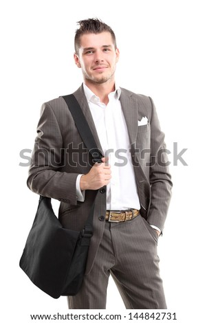 portrait of young business man holding briefcase in hand isolated on white - stock photo