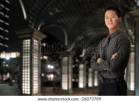 Portrait of young business man in night of city. - stock photo