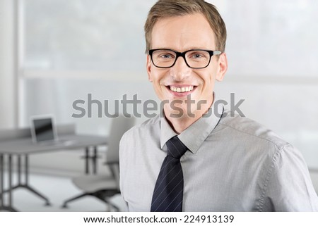 Portrait of young business man in the office - stock photo