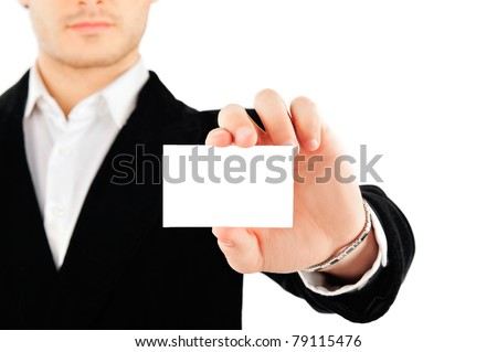 Portrait of young business man isolated on white background. Holding blank business card