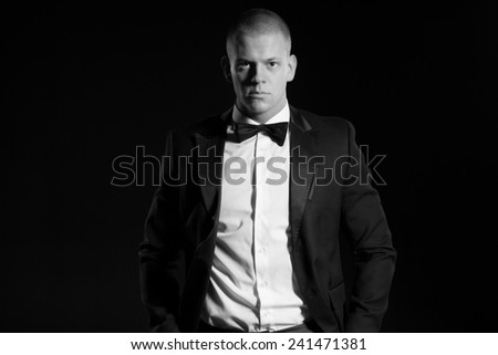 Portrait of young business man, isolated over black background
