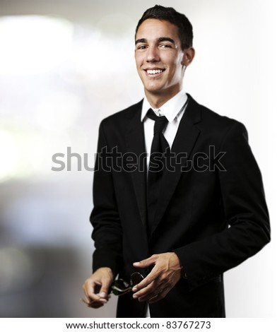 portrait of young business man laughing in a house - stock photo