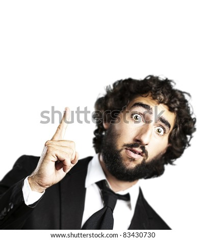 portrait of young business man pointing up against a white background - stock photo