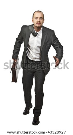 portrait of young business man running on white background - stock photo