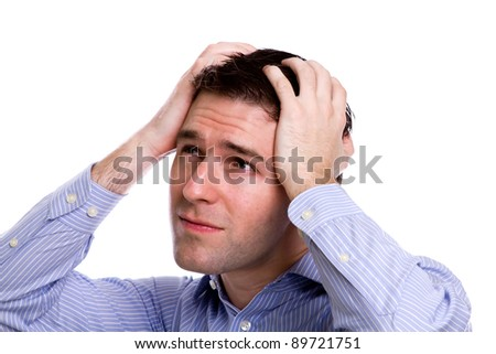 Portrait of young business man sad and worrying or having pain against white background - stock photo