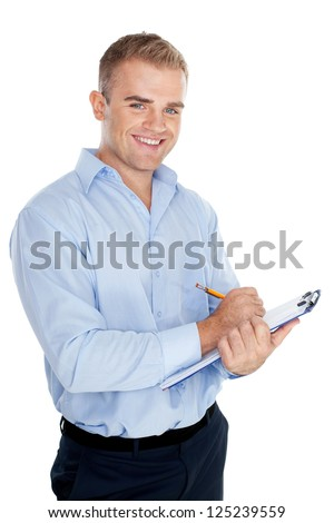 Portrait of young business man taking notes isolated on white background - stock photo